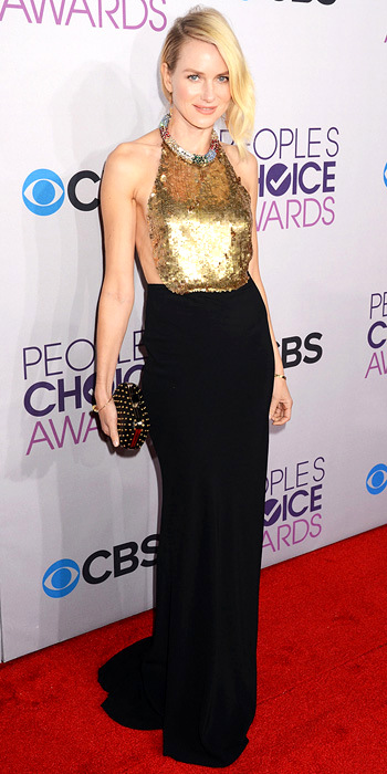 011013-naomi-watts-350Watts set off her backless Alexander McQueen column with edgy Jennifer Meyer earrings, a studded Jimmy Choo clutch and Cartier bangle at the People's Choice Awards.