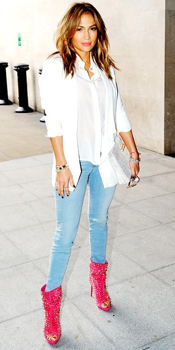 060213-jennifer-lopez-350Jennifer Lopez went sightseeing in London wearing Bec & Bridge's white blouse and blazer, skinny J Brand jeans, a python Stark clutch and studded Christian Louboutin booties.