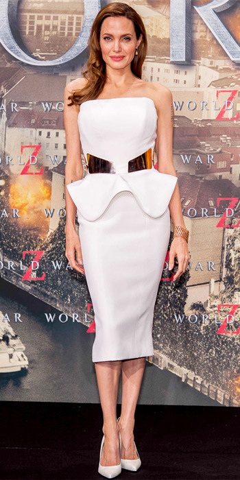060513-angelina-jolie-350 Berlin World War Z premiere, Angelina Jolie worked her curves in a belted Ralph & Russo peplum dress. Rose gold jewelry and leather stilettos completed the look