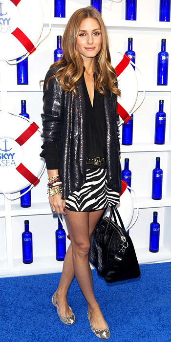 060913-lotd-olivia-palermo-350Palermo had all prints on deck at the Governors Ball music festival kick off party, cleverly mixing a sequined DVF blazer with a zebra striped Zara mini and snakeskin flats.