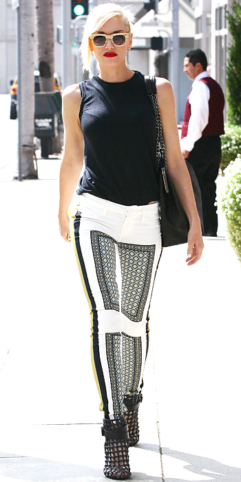 071413-gwen-stefani-350Out and about, Gwen Stefani took to the streets in a pair of printed white pants that she styled with a sleeveless black top and caged booties.