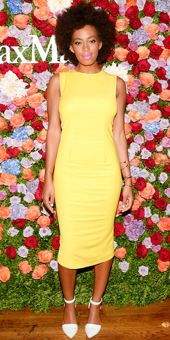 071913-solange-knowles-350Knowles feted Max Mara in a bright canary yellow sleeveless sheath, dainty gold jewelry and white ankle-strap pumps.