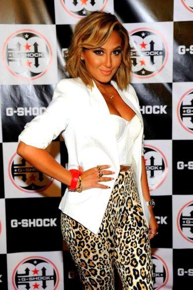 Adrienne Bailon's G-Shock Shock The World 2013 White Corset, Blazer, and Topshop Animal Print Skinny Trousers