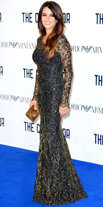 100413-Penelope-Cruz-350Cruz graced the red carpet in a navy Temperley London gown with a gold lace, complementing the metallic hue with a matching clutch.