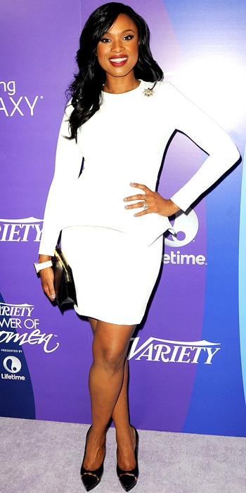 100713-Jennifer-Hudson-350Hudson stole the spotlight in a white long-sleeve Yigal Azrouel dress with peplum detailing, pairing it with a gold brooch, a Samsung Galaxy Gear watch, an