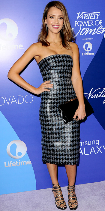 100713-Jessica-Alba-350lba worked her curves in a strapless graphite-and-black houndstooth-print Christian Dior dress. A black Dior clutch, silver and diamond Joan Hornig icicle earrings, an EF Collection diam