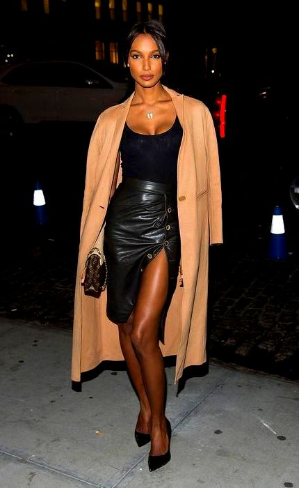 Jasmine Tookes looked seriously stunning in a leather skirt, black tank, and camel coat