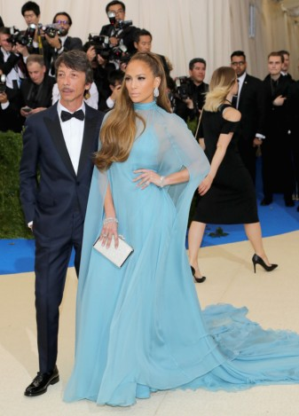 1Pierpaolo Piccioli and Jennifer Lopez attend the Rei Kawakubo Comme des Garcons